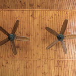 ceiling fans in covered porch and solid wall construction